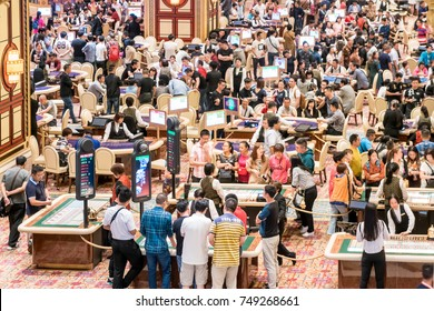 Macau, China - October 15, 2017: Aerial view of blackjack tables and gamblers inside The Venetian Casino in Macau. Macau is the capital of casinos and Asian gambling and, now, in the world.