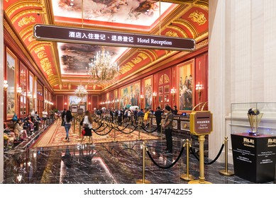 MACAU, CHINA - SEPT 15, 2017: Visitors at the Parisian hotel reception hall. Macaus gaming revenue has been the worlds largest since 2006 with the economy heavily dependent on gaming and tourism