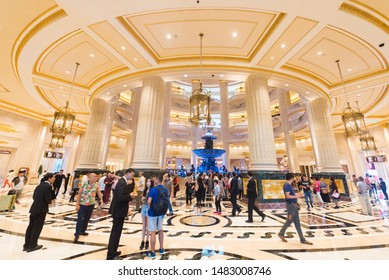 MACAU, CHINA - SEPT 15, 2017: Tourists at the Parisian hotel hall. Macaus gaming revenue has been the worlds largest since 2006 with the economy heavily dependent on gaming and tourism