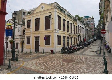 MACAU, CHINA - SEPTEMBER 12, 2013: View to the old buildings and street at the historical quarter in Macau, China.