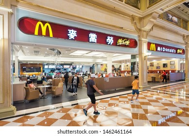MACAU, CHINA - SEPTEMBER 15, 2017: People at McDonald's in the Venetian Macao. It is a luxury hotel and casino resort in Macau owned by the American Las Vegas Sands company.