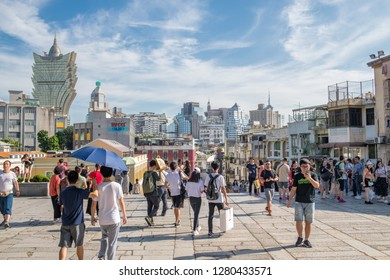 Macau, China: September 21, 2018:  Tourists in the Historic Centre of Macau.  Macau is a former Portuguese colony, but is now part of China.