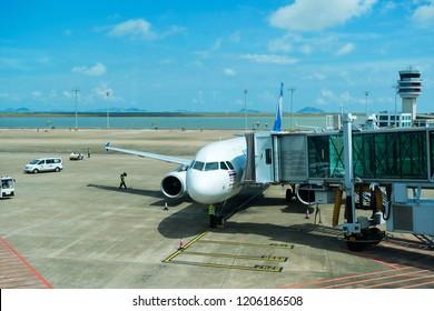 MACAU, CHINA - SEPTEMBER 23, 2018: Thai AirAsia aircraft from Thailand just arrived at Macau International Airport.