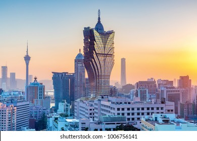 Macau, city skyline at sunset.