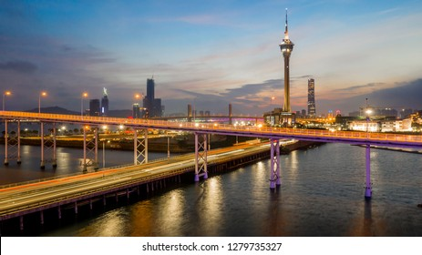 Macau city skyline at sunset with Macau Tower in twilight, Aerial view,  Macau, China.