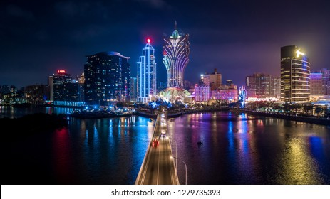 Macau cityscape skyline and skyscraper at night, All hotel and casino tower are lighten up with blue sky, Macau, Macao, China.