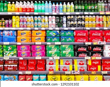 Macau, CN - OCTOBER 29, 2018: Various colorful sparkling soda cans and bottle sweet drinks that are showing on shelf in a supermarket.