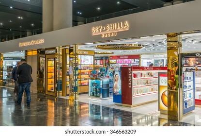MACAU - DECEMBER 1, 2015: King Power Duty Free Macau, Shilla, Sky Connection store at Macau International Airport Terminal sells liquor, tobacco, chocolate, jewelry, perfume, cosmetics, local products