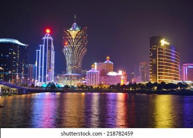 MACAU, MACAU, DECEMBER 20, 2013: Night view over illuminated casinos in Macau, local gambling paradise.