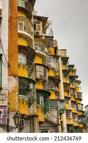 MACAU - JUNE 6, 2014:  Apartments in Macao. Macao is developing fast, but still the majority of the people live in harsh conditions. Poor quarters are around the town.