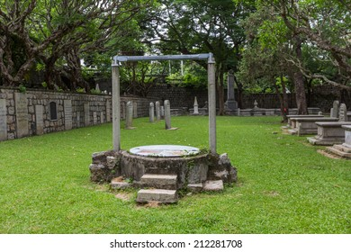 MACAU - JUNE 6, 2014: A Water well in Old Protestant Cemetery, located close to the Casa Garden, was established by British East India Company in 1821 in Macau.