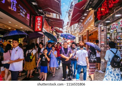 Macau, Macao Special Administrative Region of the People's Republic of China - June 2, 2018 : Busy Macau street near the Ruin's of St. Paul's, a famous tourist attraction.