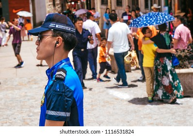 Macau, Macao Special Administrative Region of the People's Republic of China - June 2, 2018 : Police officer patrols nearby the Ruins of St. Paul's