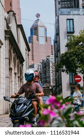 Macau, Macao Special Administrative Region of the People's Republic of China - June 2, 2018 : Alley near Senado Square, scooters are a popular mode of transport in Macau