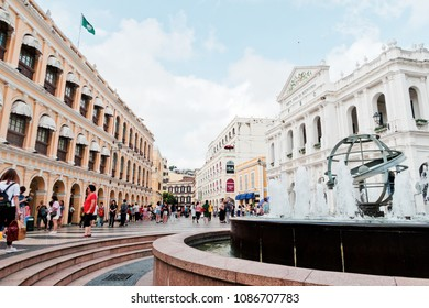 Macau - May 07, 2018 : People walking around Senado Square in Macau. Macau is a former Portuguese colony.