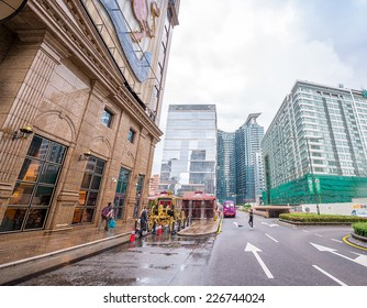 MACAU - MAY 10, 2014: Buildings of Macau on a cloudy day. Macau is one of the world's richest cities, with the highest GDP per capita by purchasing power parity as of 2013.
