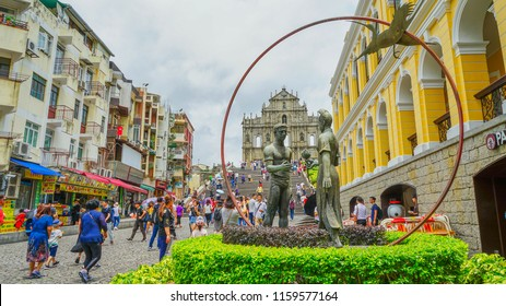 Macau - May 4th 2018: Bronze sculpture of a Portuguese man and a Chinese girl near the Ruin of St. Paul Cathedral in Macau