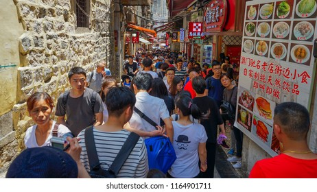 Macau - May 4th 2018: Tourist crowd shopping at shops near Ruins of St. Paul Cathedral.