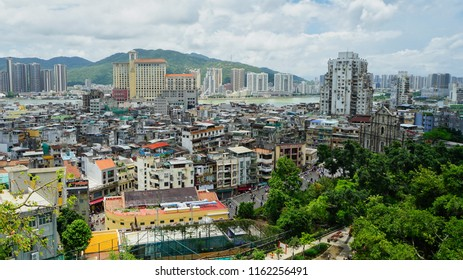 Macau - May 5th 2018: An aerial view of the city with Ruins of St. Paul Cathedral on the right side of the hill.