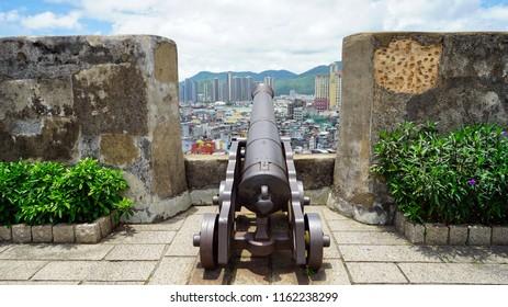 Macau - May 5th 2018: A cannon overlooking the Macau city skyline.