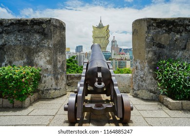 Macau - May 5th 2018: A cannon in Fort Monte overlooking the Macau city skyline and the Grand Lisboa Hotel and Casino
