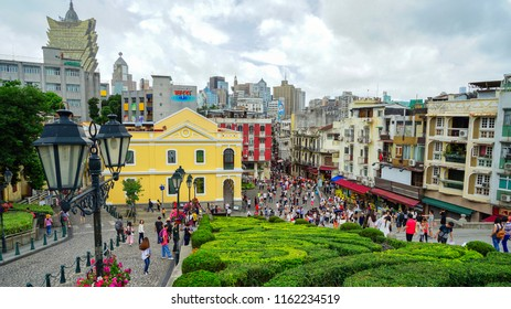 Macau - May 5th 2018: Standing at Ruins of St. Paul overlooking the city skyline.
