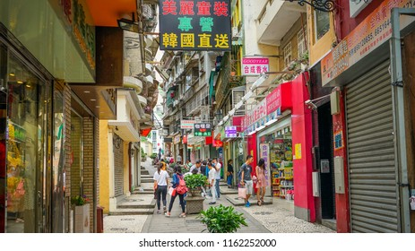 Macau - May 5th 2018: Streets of Macau with people engaging in daily activity.