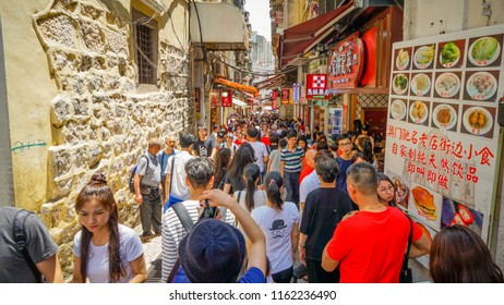 Macau - May 5th 2018: Tourist crowd shopping at shops near Ruins of St. Paul Cathedral.