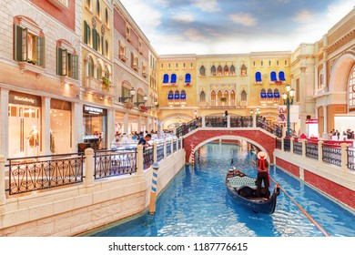 Macau - October 17, 2017: Beautiful view of gondola on the San Luca Canal inside the Venetian Macao. It is a luxury hotel, the famous shopping mall and the largest casino in the world.