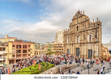 Macau - October 18, 2017: Amazing view of the Ruins of St. Paul's and colorful crowd of tourists. Macau is a popular tourist destination of Asia and leading casino market of the world.