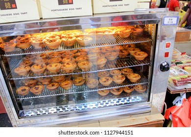MACAU OCTOBER 2011 - The pastry chef is baking the delicious tasty egg tart in the oven before the visitor coming to their store