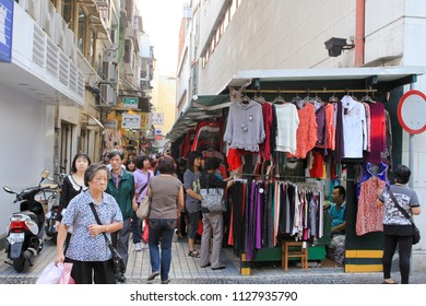 MACAU OCTOBER 2011 - Street vendors are selling clothes and apparels in Senado Square during summer holiday