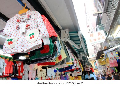 MACAU OCTOBER 2011 - Street vendors is hanging up their clothes, jacket, and t-shirt and sell it to the tourist during summer holiday