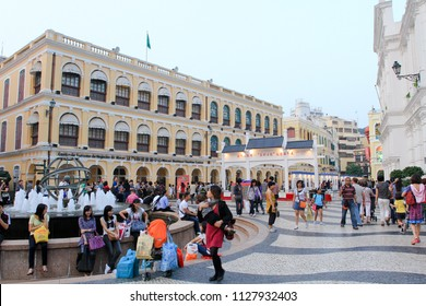 MACAU OCTOBER 2011 - Tourist and family are walking in Senado square during summer holiday