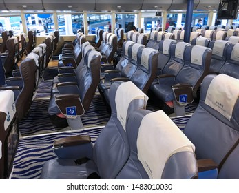 MACAU - SEPT 15, 2017: Passengers leave the board of a Cotai Water Jet ferry from Hong Kong. Cotai Water Jet is a company that operates high speed ferry services between Macau and Hong Kong