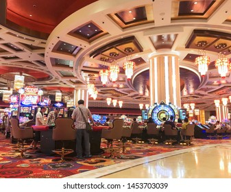 MACAU - SEPT 2017: Unidentified people play at a gaming hall of Parisian casino. Macaus gaming revenue has been the worlds largest since 2006 with the economy heavily dependent on gaming and tourism