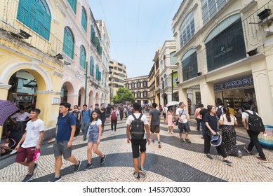 MACAU - SEPTEMBER 16, 2017: Lots of people stroll downtown Macau, a major resort city and the top destination for gambling tourism.