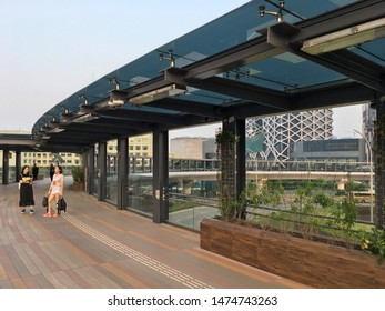 MACAU - SEPTEMBER 16, 2017: People at an elevated ring viaduct near the Venetian casino resort complex. Macau is a resort city in Southern China known for its casinos and luxury hotels.