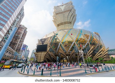 MACAU - SEPTEMBER 16, 2017: People stroll in front of the Grand Lisboa hotel, the tallest building in Macau and the most distinctive part of its skyline