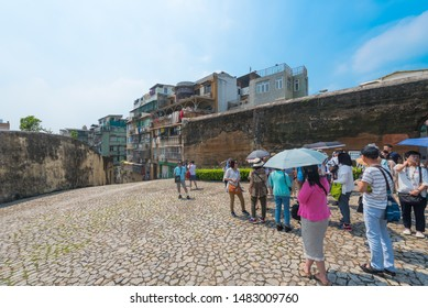 MACAU - SEPTEMBER 16, 2017: Unidentified tourists in the historical center of the city, a major resort city in Southern China and the top destination for gambling tourism.