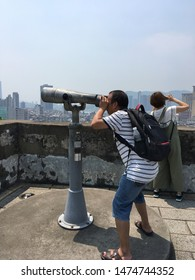 MACAU - SEPTEMBER 2017: A man looks through binoculars at Monte Fort. Fortaleza do Monte is a fort in Santo Antonio. It is the historical military centre of Macau.