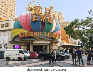 MACAU - SEPTEMBER 2017: People in front of the Casino Lisboa, owned by a Stanley Ho company. Ho has been nicknamed King of Gambling for he held monopoly on the Macau gambling industry for 75 years.