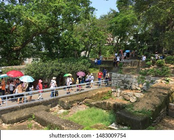 MACAU - SEPTEMBER 2017: Unidentified people stroll in the park of Monte Fort. Fortaleza do Monte is a fort in Santo Antonio. It is the historical military centre of Macau.