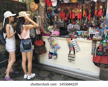 MACAU - SEPTEMBER 2017: Unidentified women shop at souvenir stalls in the park of Monte Fort. Fortaleza do Monte is a fort in Santo Antonio. It is the historical military centre of Macau.