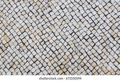 Macau tiles on the road