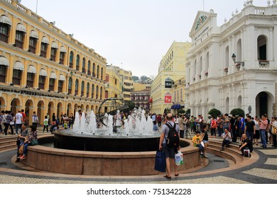 MACAU,CHINA APRIL 20: Crowd people for tourism in Macau historic area of city in 20 april 2014. chinese tourists are the main resource in macau tourism industry now