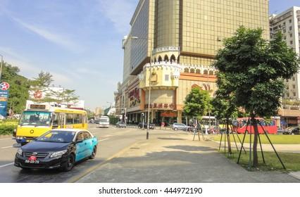 MACAU/CHINA - NOVEMBER 26 2013: Streets and buildings of Macau in China near Hong Kong