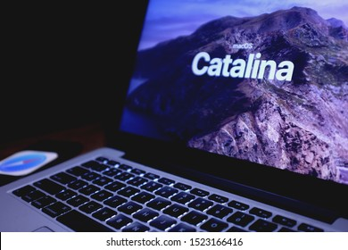 Macbook with the Mac OS Catalina logo which is Apple's desktop operating system for Macintosh computers in the United States, New York. Sunday, October 6, 2019