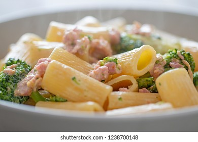 Maccheroni with sausage, cream and broccoli.