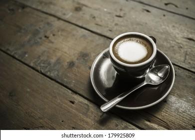 Macchiato coffee on old wood table